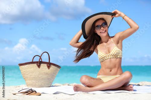 fd517c1218d Happy beach vacation woman enjoying the sun in bikini and sunglasses having  fun on a windy