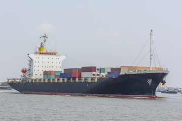 Commercial cargo ship carrying containers arriving port