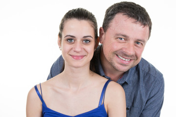 Man and his teenage Daughter isolated on white