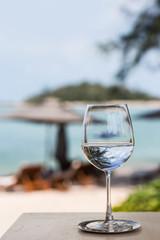 Beach restaurant serving, glasses, plates, juice, cocktails.