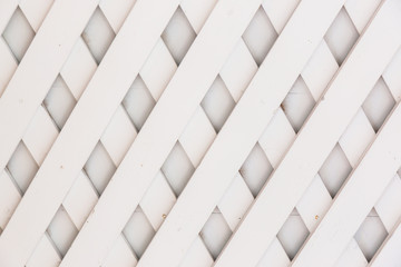 Wooden fence lattice pattern.