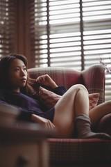 Brunette relaxing on the sofa