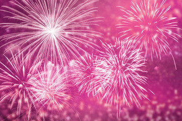 Fototapete - Pink fireworks at celebrate and copy space.