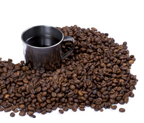 the scattered coffee grains and steel mug