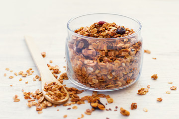 Freshly Granola on white background close-up, selective focus. h