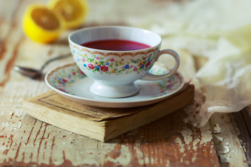 Cup of tea on wooden table. vintage scene.