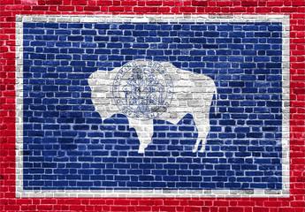 Wyoming US flag painted on old vintage brick wall
