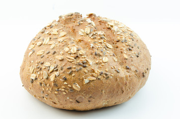 Bun with sesame seeds and oat flakes