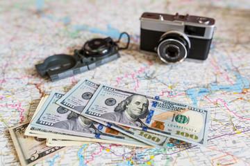 Travel set: money, camera, road map, compass