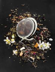 Herbal tea with flowers in tea strainer