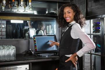 Happy barmaid preparing a bill