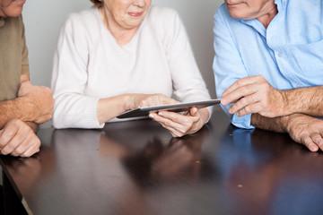 Senior Students Using Tablet Computer At Desk