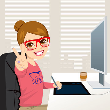 Beautiful hipster fashion style graphic designer woman working with tablet in front of computer screen