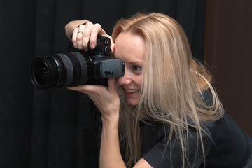 female photographer taking pictures indoors