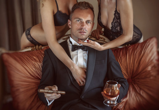 Gentleman in the company of two sexy women