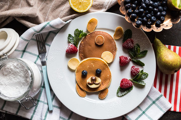 Top view on pancakes in the shape of a bear