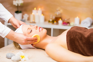 Woman having facial procedures at spa