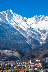 Austria, Tyrol, panoramic wiew over Innsbruck and Inn valley with the snowy mountains in the background