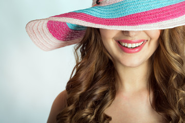 woman with a hat in the hot summer