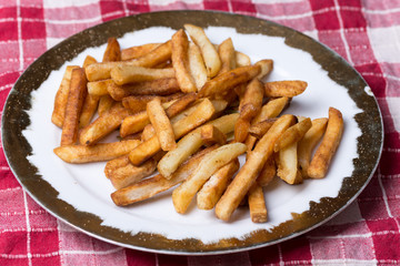 Fresh fried french fries on the plate