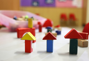 many wooden toys and pieces of buildings in the nursery class