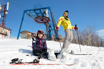 Two girls skier on a mountain top