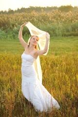 Bride Posing in the Sunlit Field