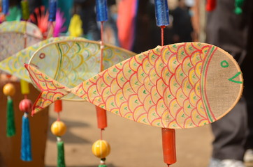 Colourful wall hangings at the Surajkund International Crafts Mela in India