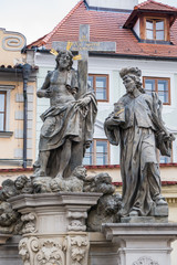 Statue of the Holy Savior with Cosmas and Damian on Charles Bridge in Prague