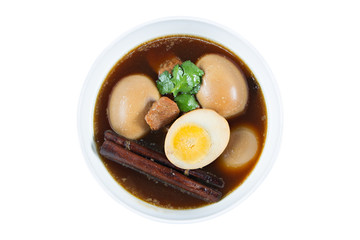 Eggs boiled in the gravy with spices isolated on white. Thai cui