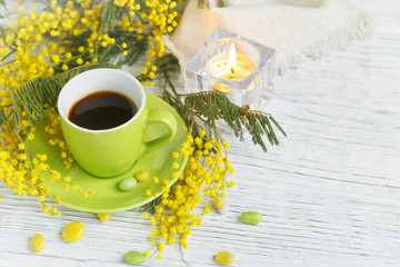 mimosa, lemon and coffee on light wooden background