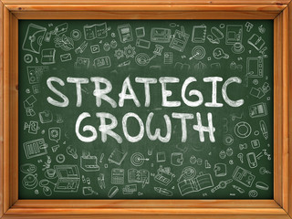 Strategic Growth - Hand Drawn on Chalkboard. Strategic Growth with Doodle Icons Around.