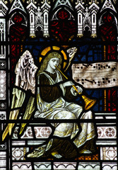 Fototapete - Angel making music (trumpet) in stained glass