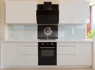 Interior of a modern white and black kitchen