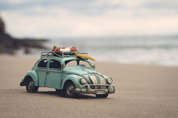 Miniature car in the beach for holidays. Copy space