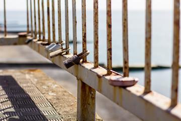 Love padlocks hanging on a bridge in Adler