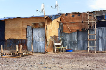 Hurdle and corrugated sheet made hut. Afrera-Ethiopia. 0176