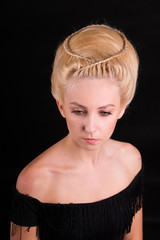Hairdresser styling with a big bun on a woman's head