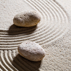 Acrylic Prints Stones in Sand zen sand still-life - textured stones set across sinuous waves for concept of different directions or change with inner peace, closeup