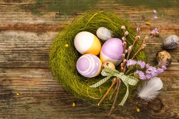 Painted Easter eggs in the nest