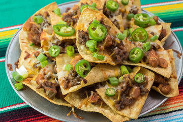 Homemade baked nachos with beef and pinto beans.