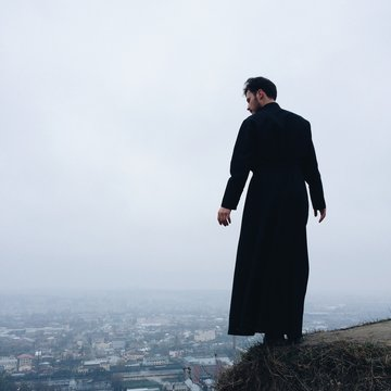 lonely priest on mountains