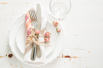Romantic table setting with died flowers