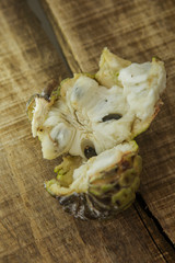 Closeup Broken Ripe Sugar-apple on Brown Table