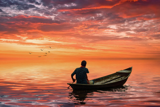 A man riding boat in bangladesh