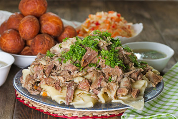 National Kazakh dishes: Beshbarmak, salad of radish Shalgam, and Baursak.