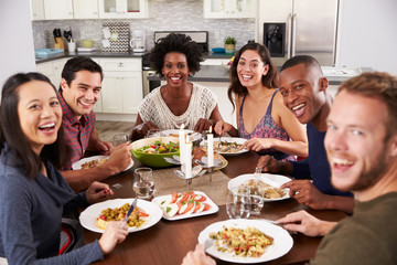 Portrait Of Friends Enjoying Dinner Party At Home