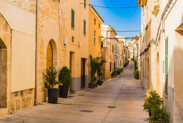 Fototapete - View of an mediterranean alleyway with rustic buildings
