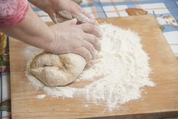 Women's hands prepairing fresh yeast dough