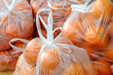 Mandarin oranges in transparent plastic bags, one kilo in weight, in a fruit and vegetable shop